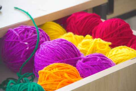 close up photography of colorful yarns